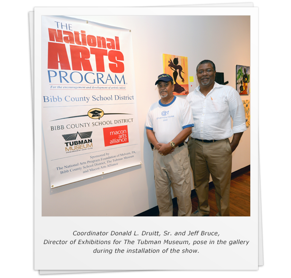 Coordinator Donald L. Druitt, Sr. and Jeff Bruce, Director of Exhibitions for The Tubman Museum, pose in the gallery during the installation of the show.