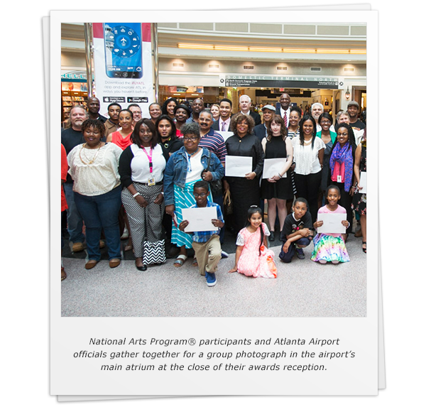 National Arts Program® participants and Atlanta Airport officials gather together for a group photograph in the airport's main atrium at the close of their awards reception.