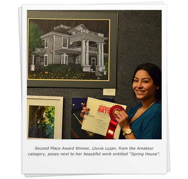 "Second Place Award Winner, Lluvia Lujan, from the Amateur category, poses next to her beautiful work entitled ""Spring House""."