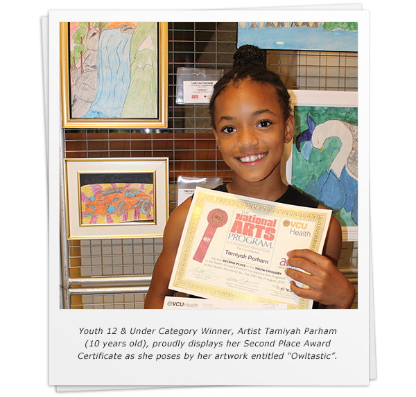 "Youth 12 & Under Category Winner, Artist Tamiyah Parham (10 years old), proudly displays her Second Place Award Certificate as she poses by her artwork entitled ""Owltastic"""