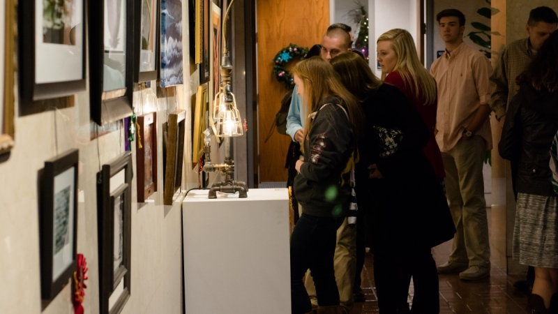 Attendees taking in the artwork on display at the Block Gallery during the awards