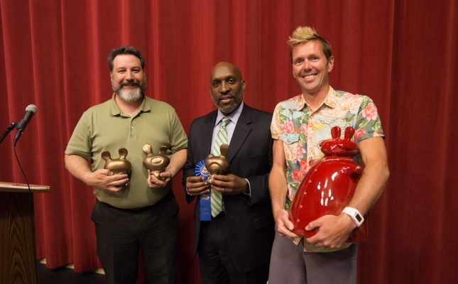 """City Council Member Marty Campbell and City Manager T.C. Broadnax posing with First Place Professional Winner, Christopher Hoppin and his work entitled """"Mao and his Tuzi Army""""."""