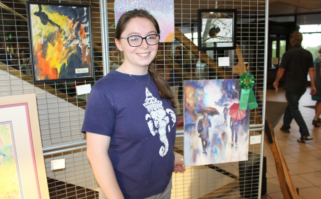 """Mikayla Martin poses with her work entitled """"Rainy Day"""""""