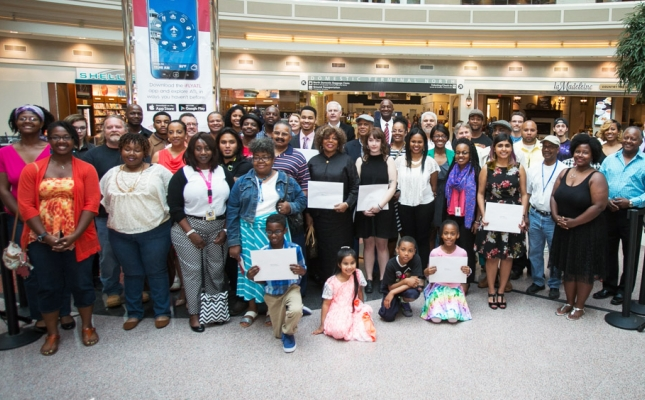 National Arts Program® participants and Atlanta Airport officials gather together for a group photograph in the airport's main atrium.