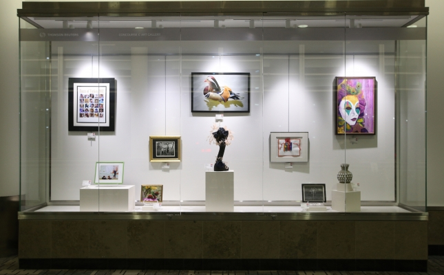 One of the beautiful display cases that are part of the MSP National Arts Program® show which is hung in the Thomson Reuters Concourse C Art Gallery.