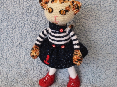 Poppy, calico cat in a sailor outfit; crochet doll on wire carcass with movable arms, legs and tail